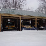 snowmobile trail groomers in new storage barn