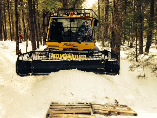 Pushing snow to fill in a brook crossing on the new 109 trail